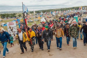 Water protectors from the Oceti Sakowin Seven Council Fires Camp marching. Photo by Andrew Cullen, Reuters