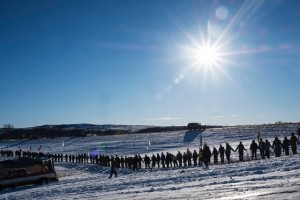 Celebratory circle around camp on Dec. 4 after Army Corps announcement, photo by Christian Hansen for Slate.com