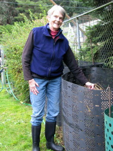 Ann checking temperature of newly made compost