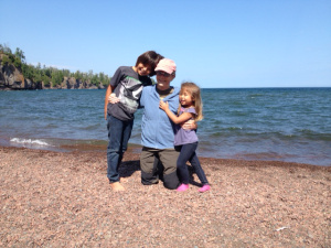 Jaden, Grandma Ann, and Sasha on the shore of Lake Superior