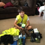 Jaden with his stash of new camping gear
