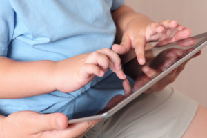 Child and mother using a digital tablet