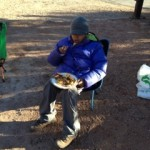 Young ornithologist eating his waffle and sausage breakfast