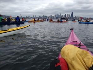 Kayaks heading out toward Seattle's skyline