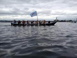Native canoe signaling us off the beach