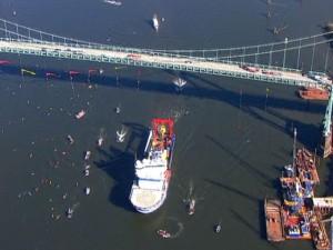 Icebreaker Fennica traveling under the Portland Bridge with a Coast Guard escort
