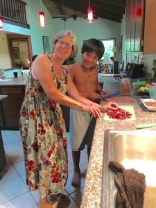 Christina and Jaden preparing fresh fish